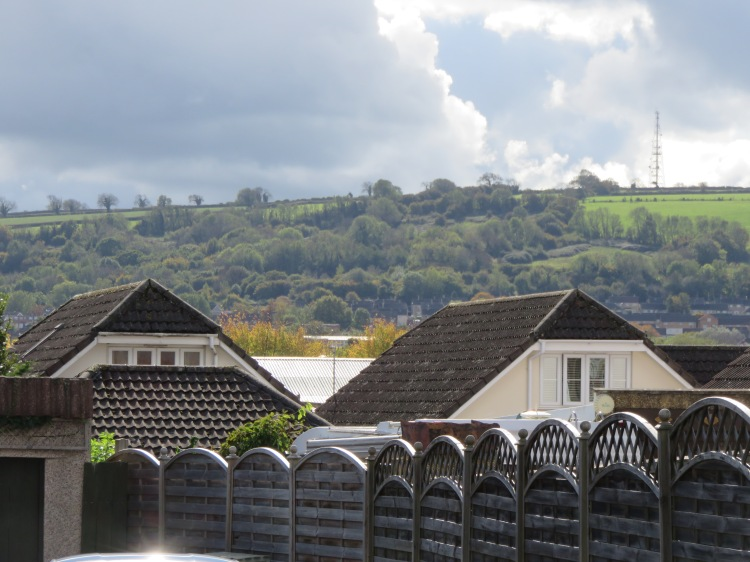 Dundry hill rises in the distance